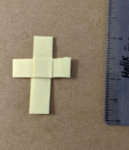 palm cross with ruler for scale